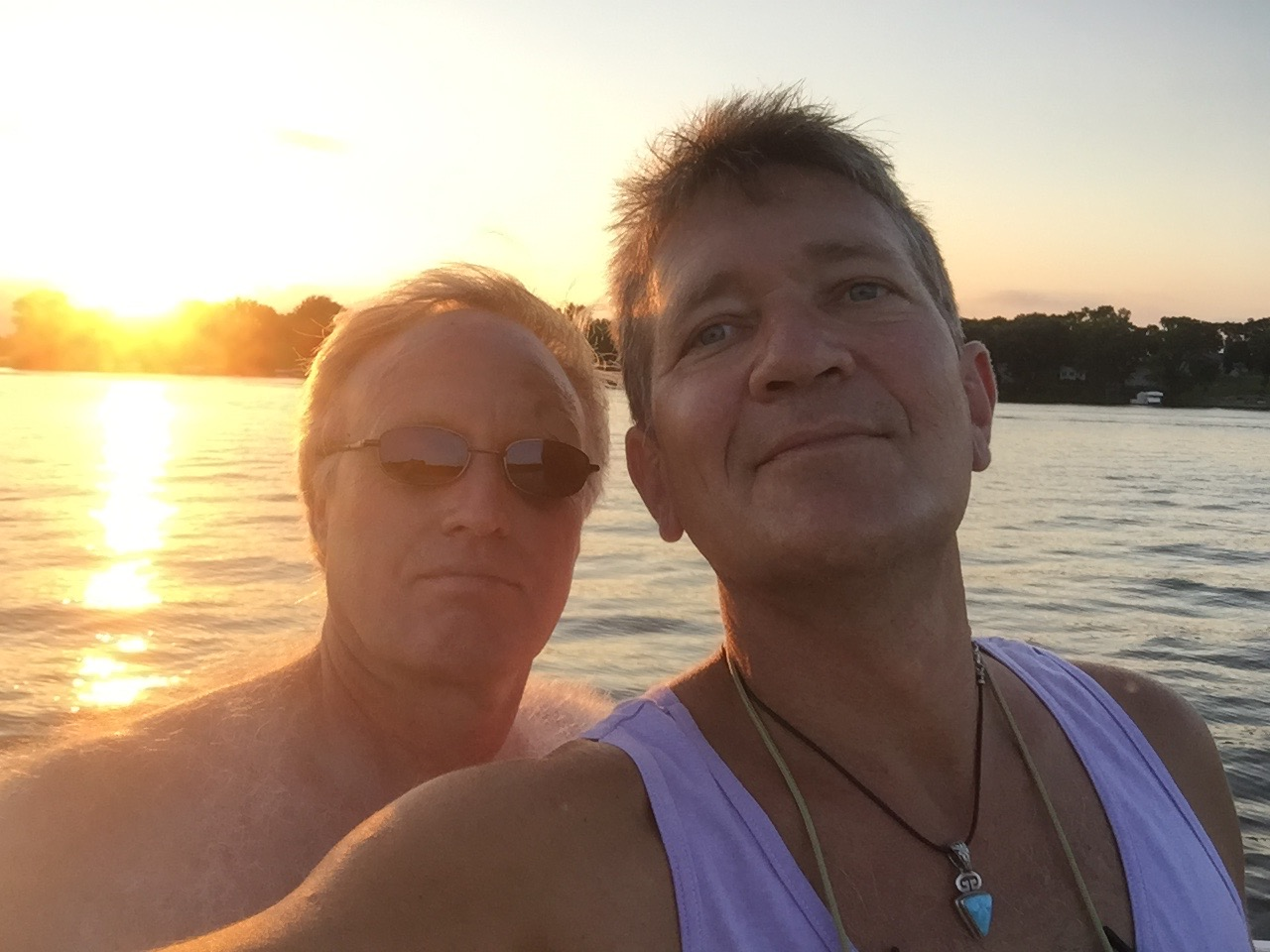 Meet Scott, proudly representing my so many friends. Scott's a BFF since 2nd grade, growing up in Soo Siddy and beyond, who spent the last few days prepping (and partying) with me at home on Lake Owasso. In this pic, we are afloat at Boji just a few weeks ago.